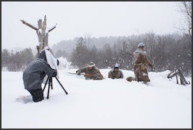 Steven Oatley capturing a high action shot in the snowy trenches